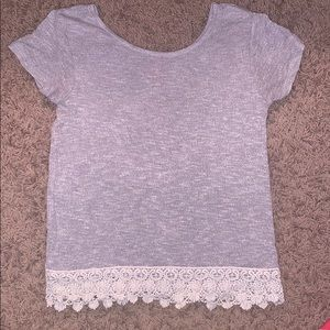 I'm selling a gray shirt from the brand Arizona.